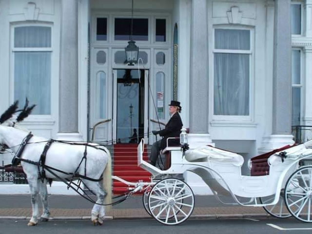 Vis A Vis Carriage is a luxury carriage seats 4 adults comfortably in the rear with front seat for driver and groom.